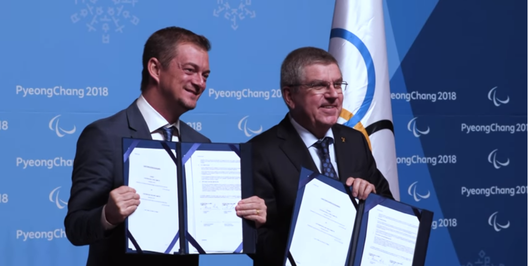 IOC President Thomas Bach, right, and IPC counterpart Andrew Parsons, left, have signed a historic long-term agreement establishing a partnership of the two organisations until at least 2032 ©YouTube