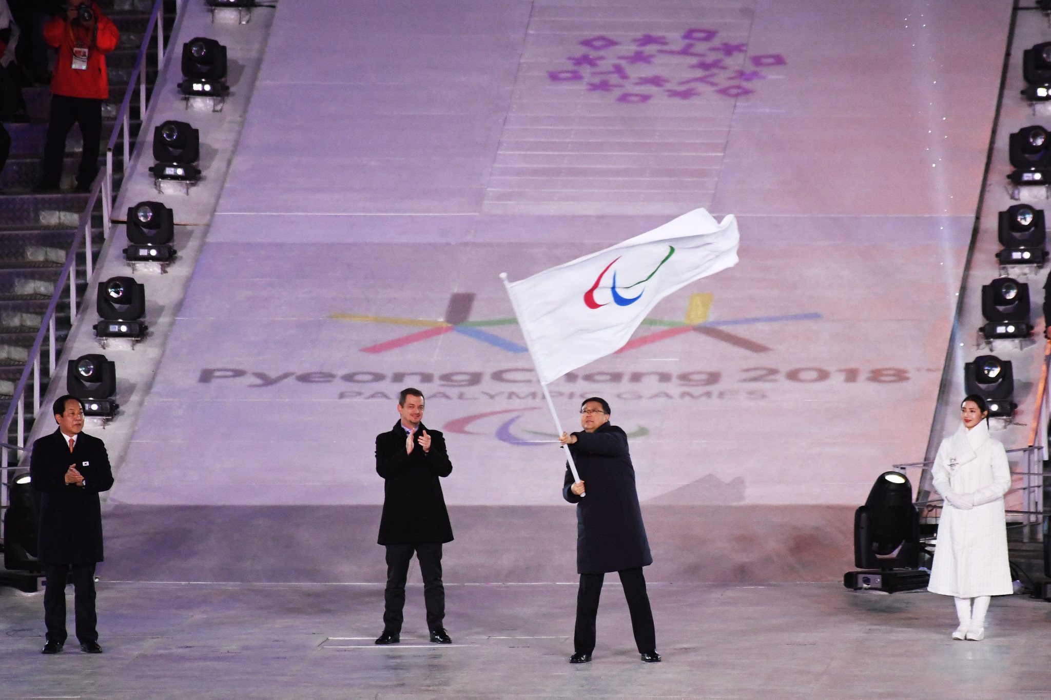 Mayor Chen Jining of Beijing waves the flag after receiving it from International Paralympic Committee President Andrew Parsons at the Closing Ceremony of Pyeongchang 2018 ©Getty Images