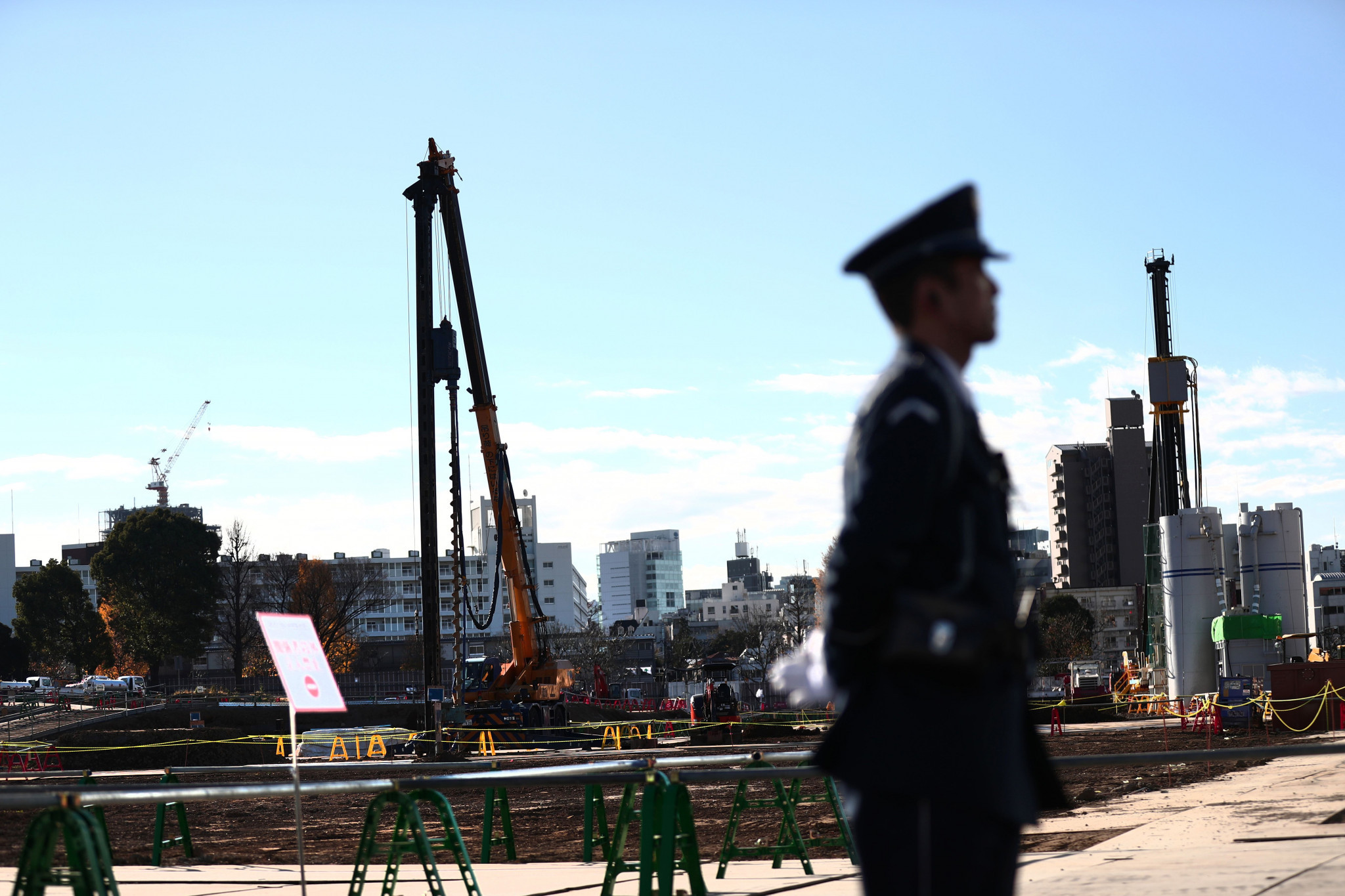 A security guard at the Tokyo Olympic Stadium construction site