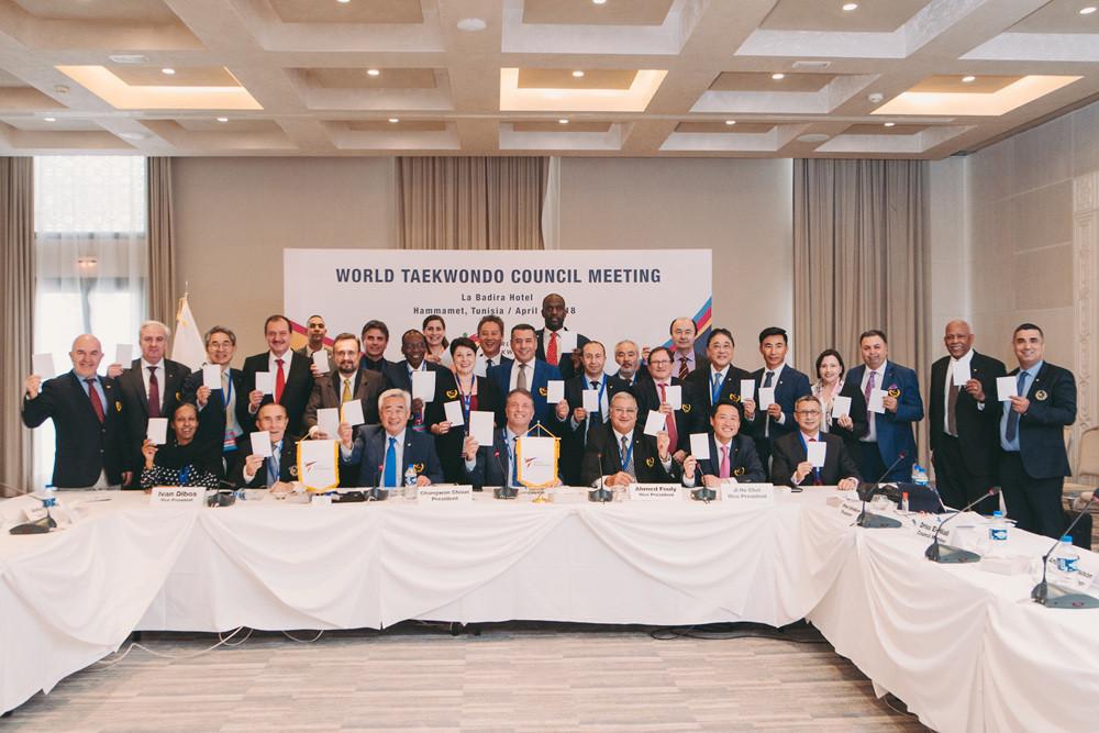 World Taekwondo members hold the White Card after approving the Hammamet Declaration ©World Taekwondo