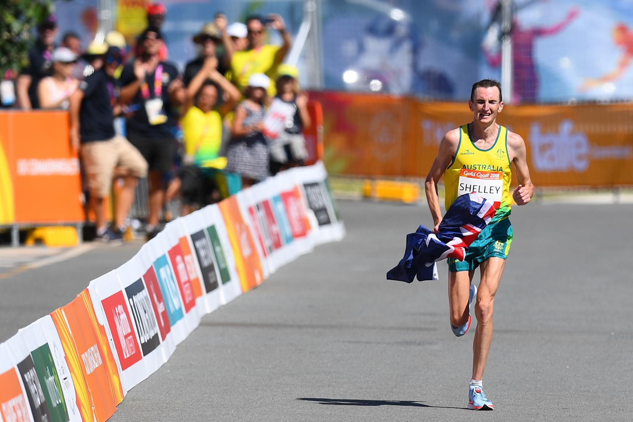 Shelley defends men's marathon title after leader Hawkins collapses near finish