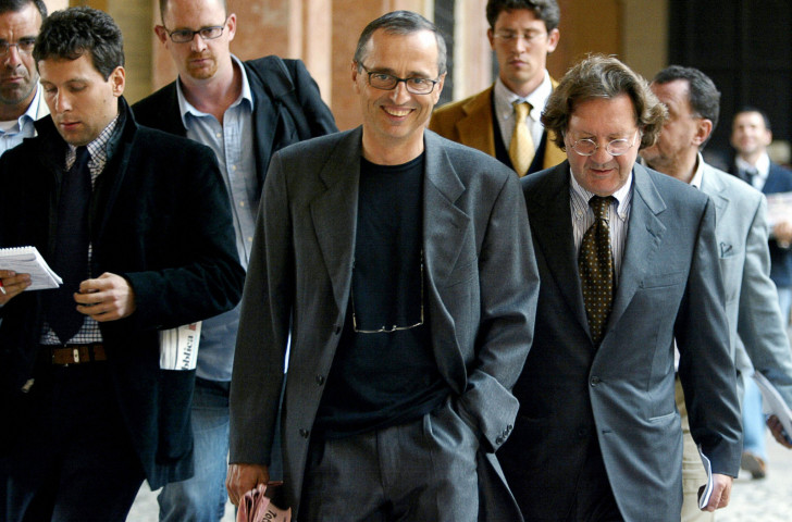 El Pais reports CAS hearing material showing Dr Michele Ferrari, pictured centre after a tribunal appearance in 2004, supplied EPO to Spanish track cyclists at the 1996 Olympics in Atlanta ©Getty Images