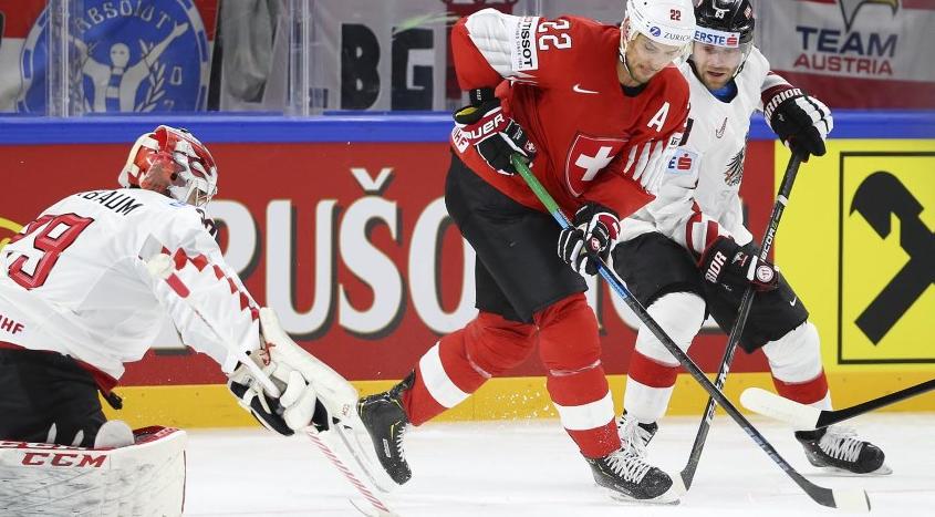 Switzerland beat Austria in overtime today ©IIHF