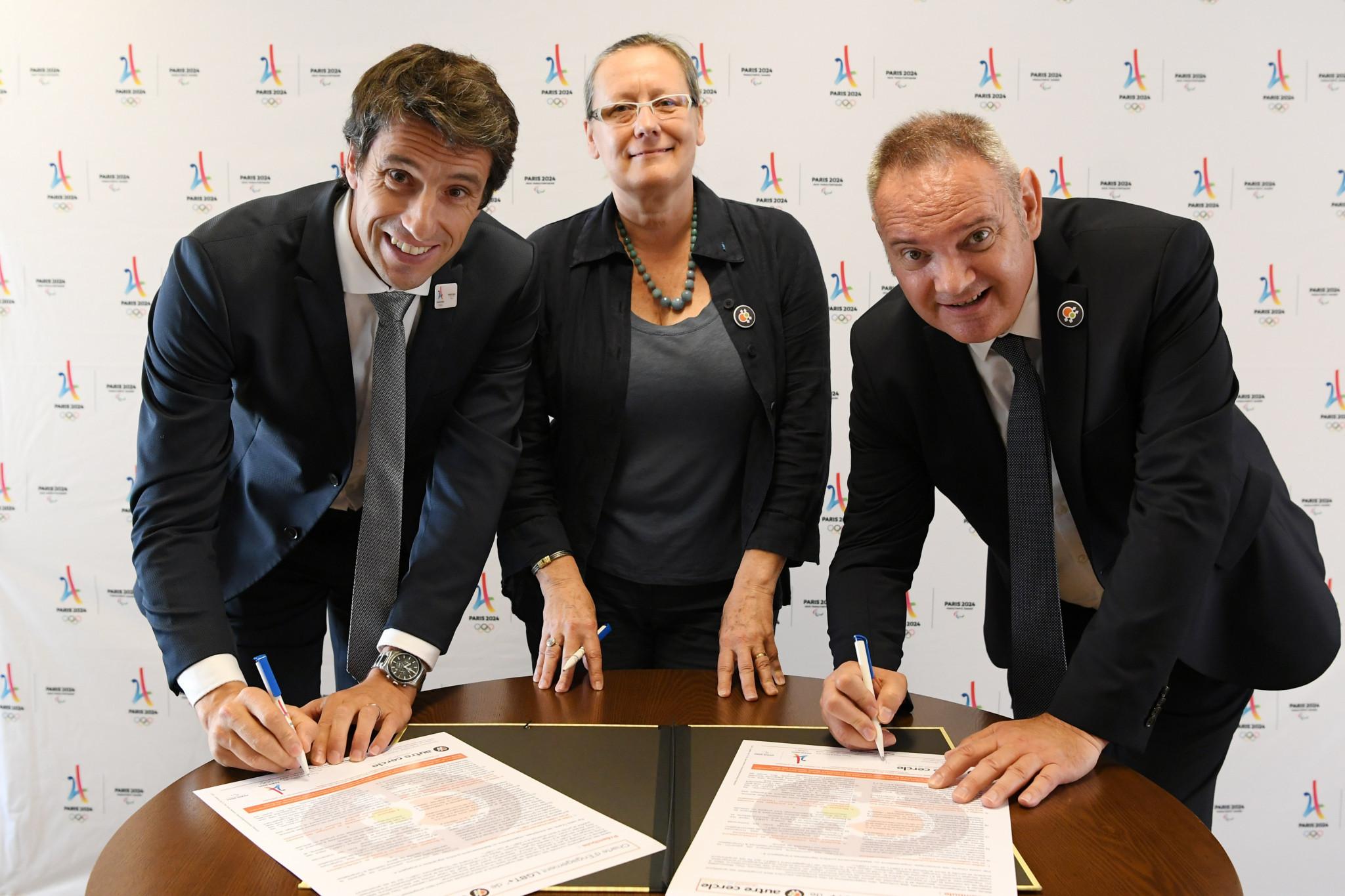 Paris 2024 President Tony Estanguet, left, signed an LGBT engagement charter ©Paris 2024