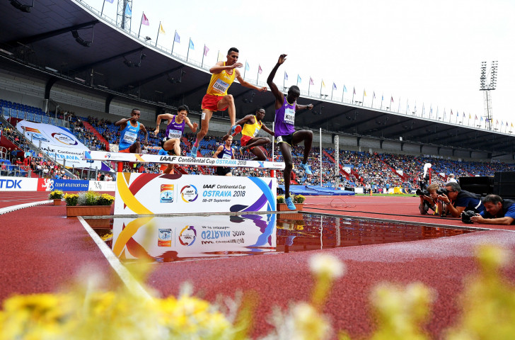 Soufiane El Bakkali, yellow, competing in the men's 3,000m steeplechase at the Continental Cup, clearing the water jump hurdle in a race where he would later be injured ©Getty Images