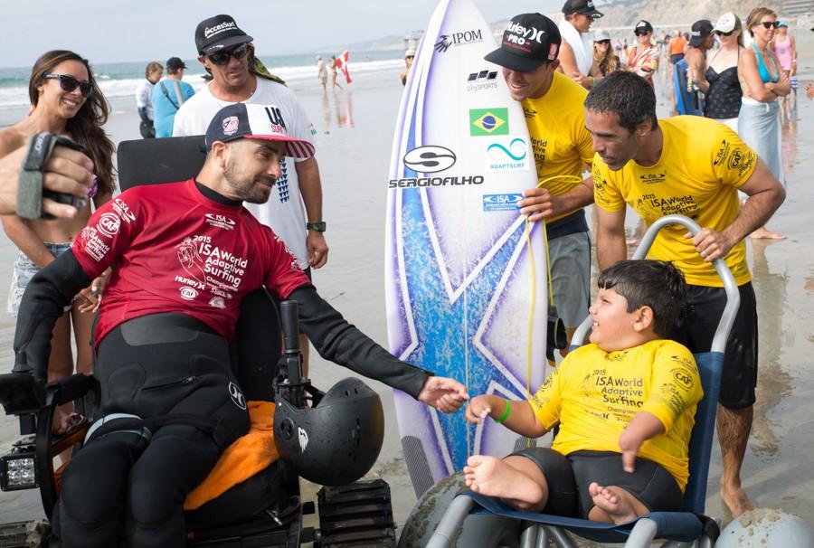 Assist winner Jesse Billauer congratulates ten-year-old Davi Teixeira who won silver for Brazil