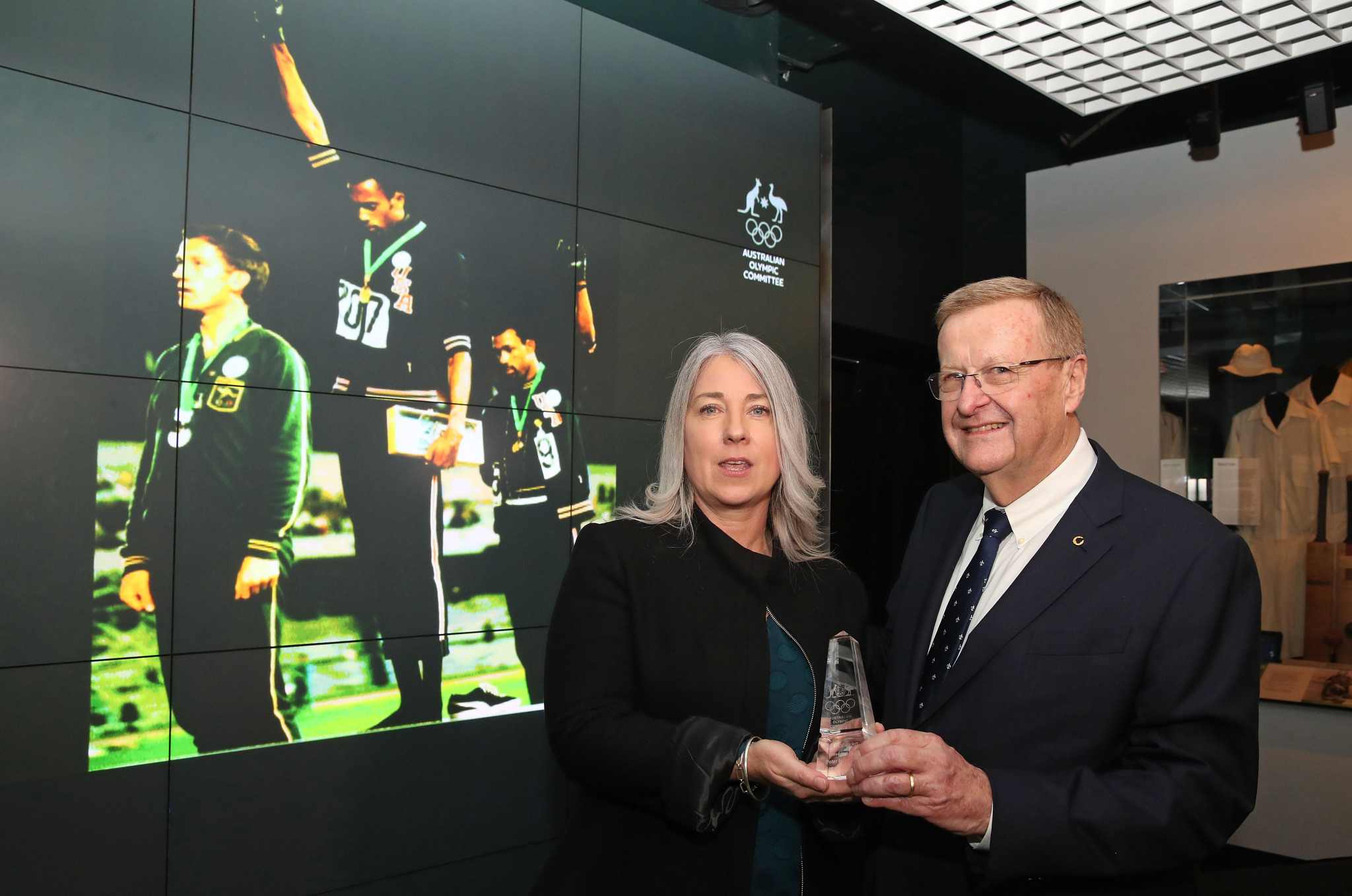 Peter Norman's daughter receives the Order of Merit from the Australian Olympic Committee on behalf of the late Peter Norman ©Getty Images