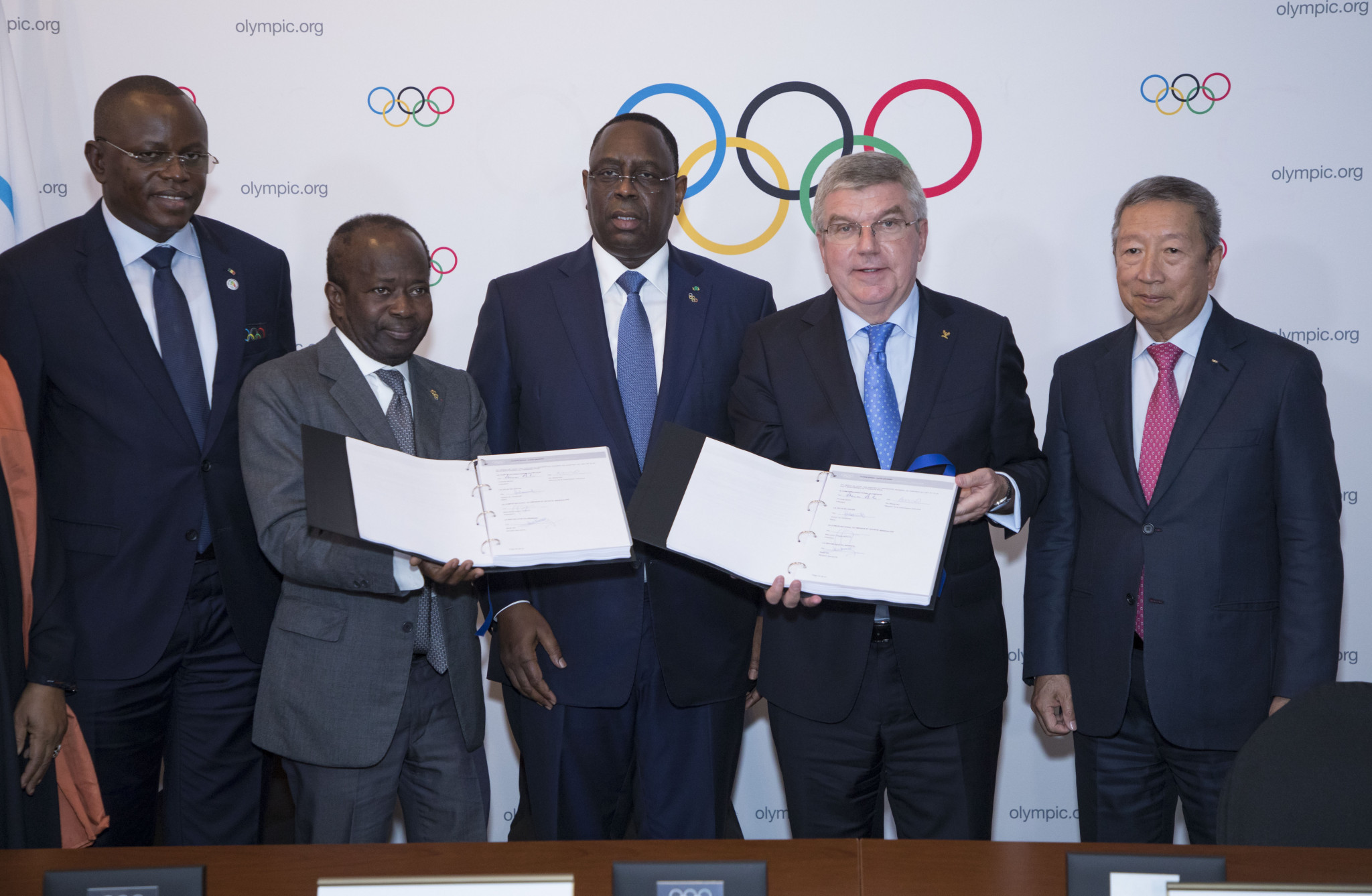 Sebastian Coe approached Senegalese President Macky Sall, centre left, after he had led the delegation that helped his country win its bid to be awarded the 2022 Summer Youth Olympic Games ©IOC