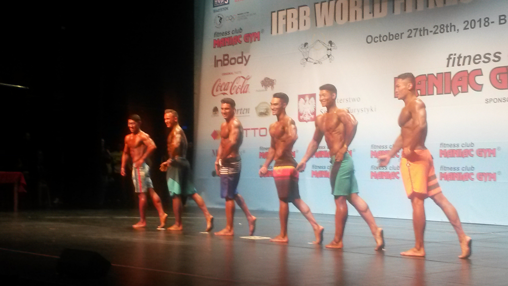 China's Liu Maoyi, third from the right, won his under 179cm category and overall men's physique gold on the first day of the IFBB World Fitness Championships in Bialystok, Poland ©ITG