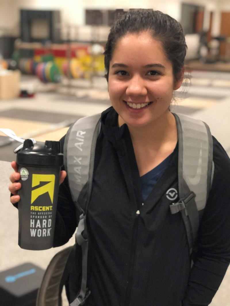 Jourdan Delacruz, a member of the United States' team for the 2018 IWF World Championship, drinks Ascent Protein following training at a camp in Leimen in Germany ©USA Weightlifting
