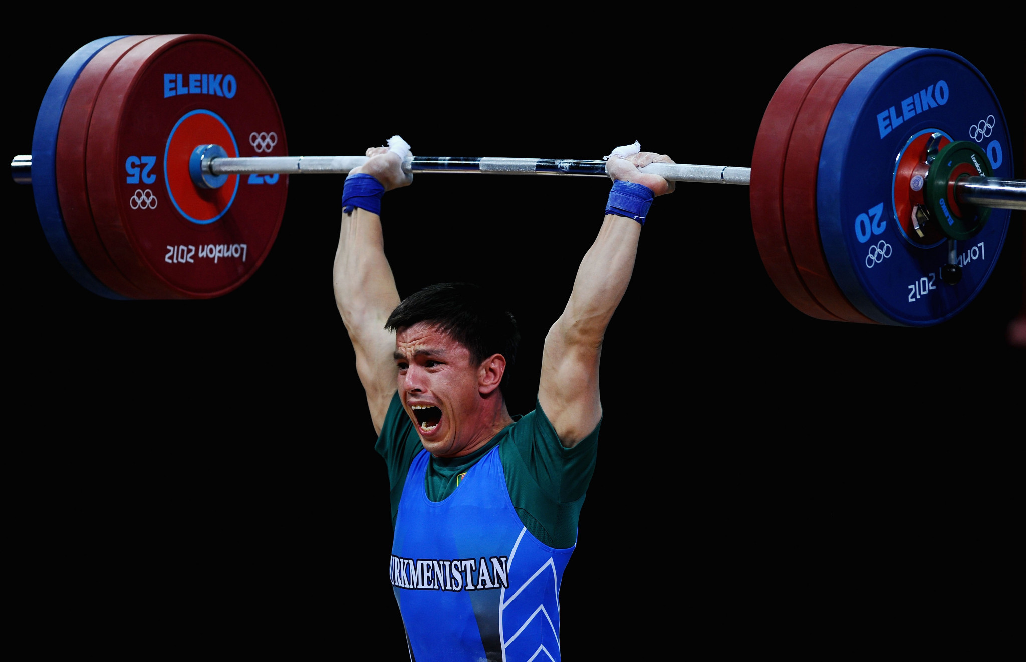 Umurbek Bazarbayev, lifting here at London 2012, has reportedly been hired as a coach despite being a suspended doper ©Getty Images
