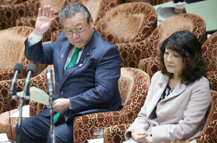 Yoshitaka Sakurada, left, the deputy chief of the Government's cyber-security strategy office and also the Minister in charge of the Tokyo 2020 Olympic and Paralympic Games,  caused disbelief by saying he had never used a computer ©Getty Images
