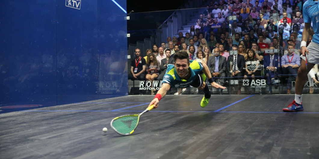 Miguel Rodriguez dives for the ball against Mohamed Elshorbagy during the 2018 British Open final - spectacular action of the kind that is going down well with YouTube viewers ©PSA