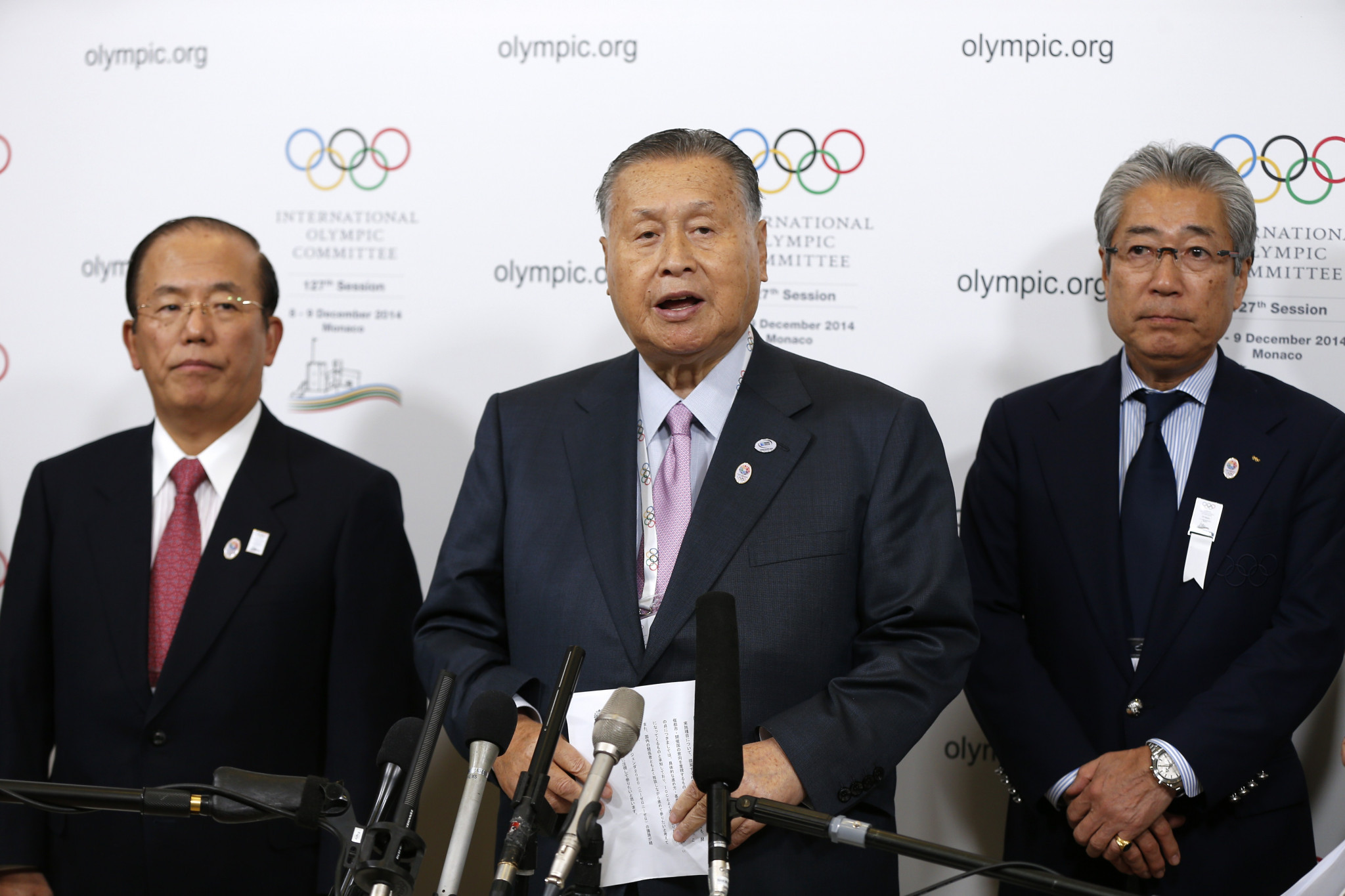 Tokyo 2020 chief executive Toshirō Mutō, left, has backed Tsunekazu Takeda, right, to remain as Japanese Olympic Committee President, despite being at the centre of a corruption scandal linked to the city's successful bid ©Getty Images