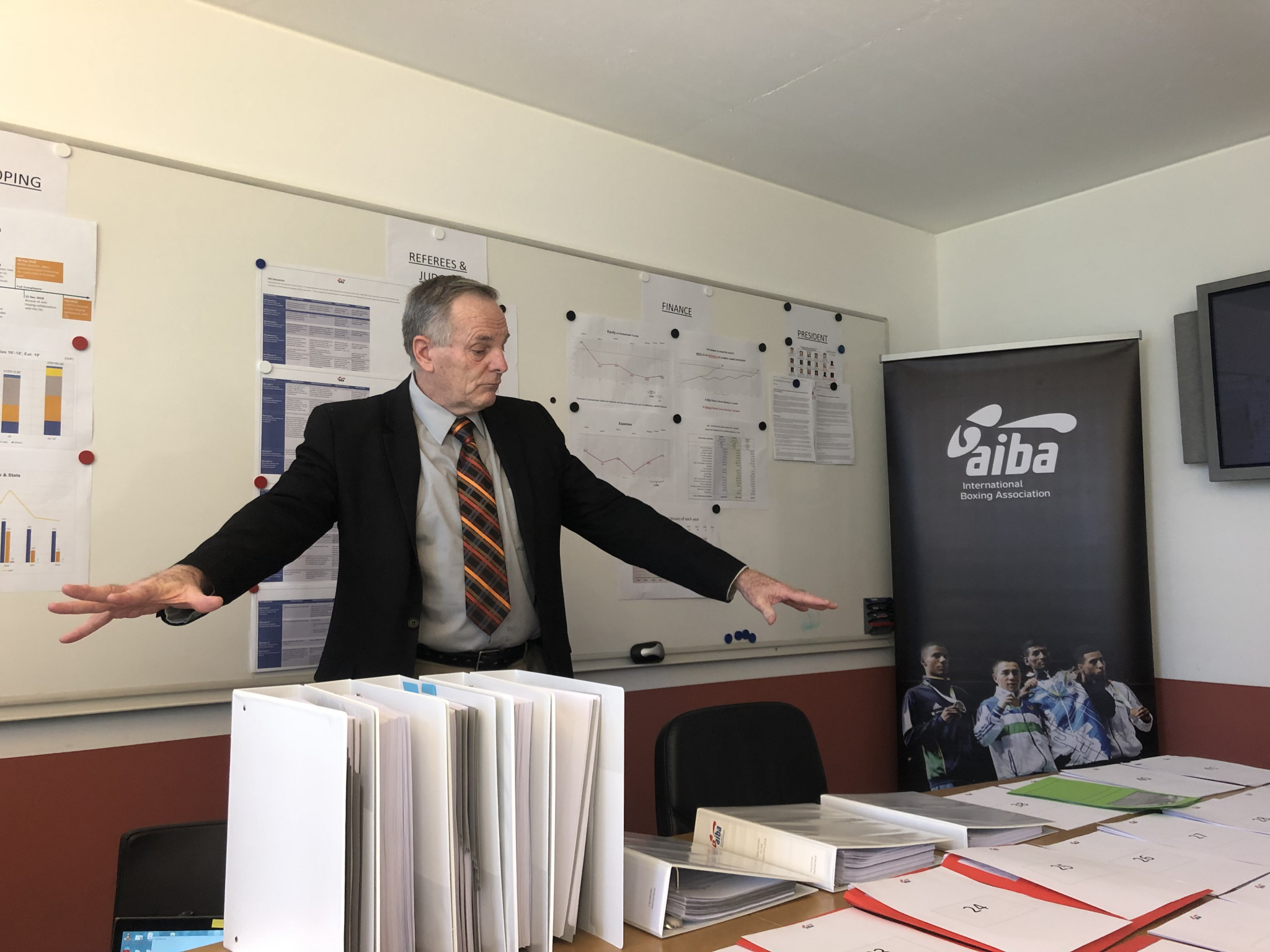 AIBA executive director Tom Virgets shows off all the paperwork he claims will provide answers to the 41 questions the IOC have asked, including about its controversial President Gafur Rakhimov ©ITG