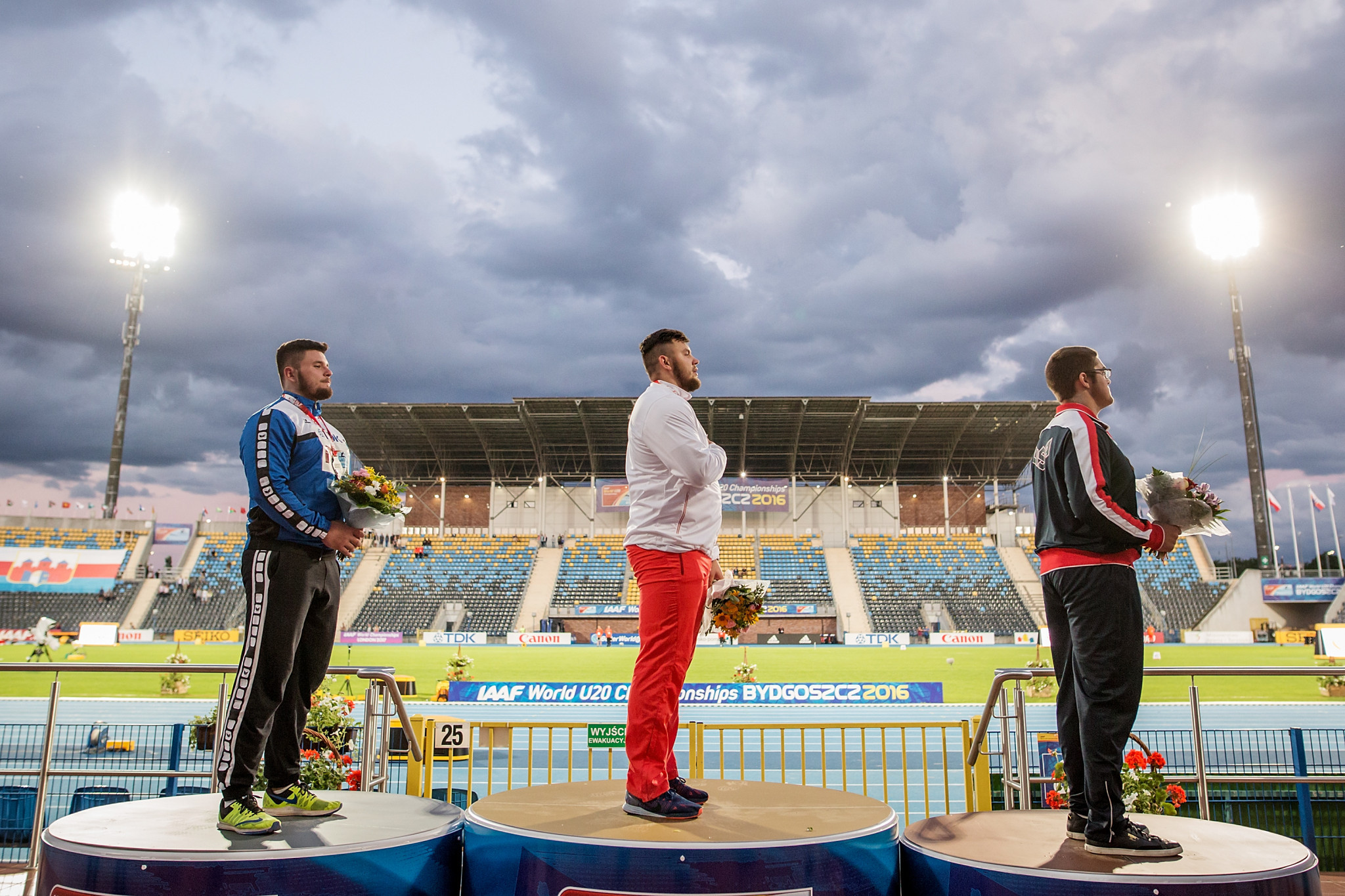 America's Bronson Osborn, right, is set to be upgraded to the gold in the shot put at the 2016 World U20 Championships after the two ahead of him, Poland's  Konrad Bukowiecki, centre, and Romania's Andrei Toader, left, failed drugs tests ©Getty Images