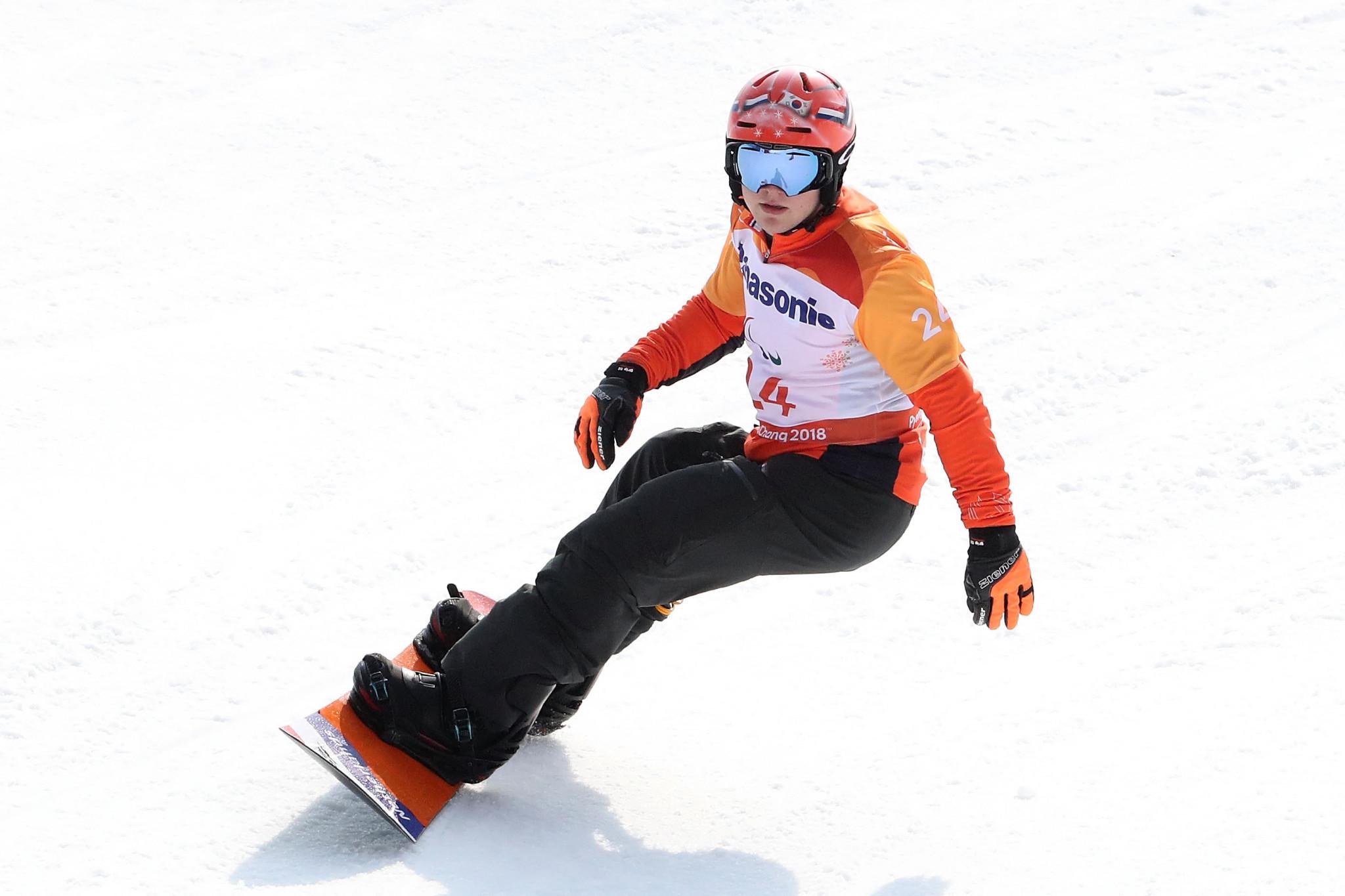 Dutchman Chris Vos beat favourite Reinhold Schett of Austria to clinch gold in the men's snowboard cross SB-LL1 event ©Getty Images