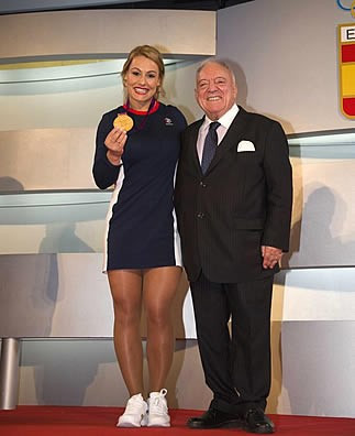 Spain's Lidia Valentín, pictured here with IWF President Tamás Aján, has officially made history as the first female weightlifter to medal at three Olympic Games ©IWF