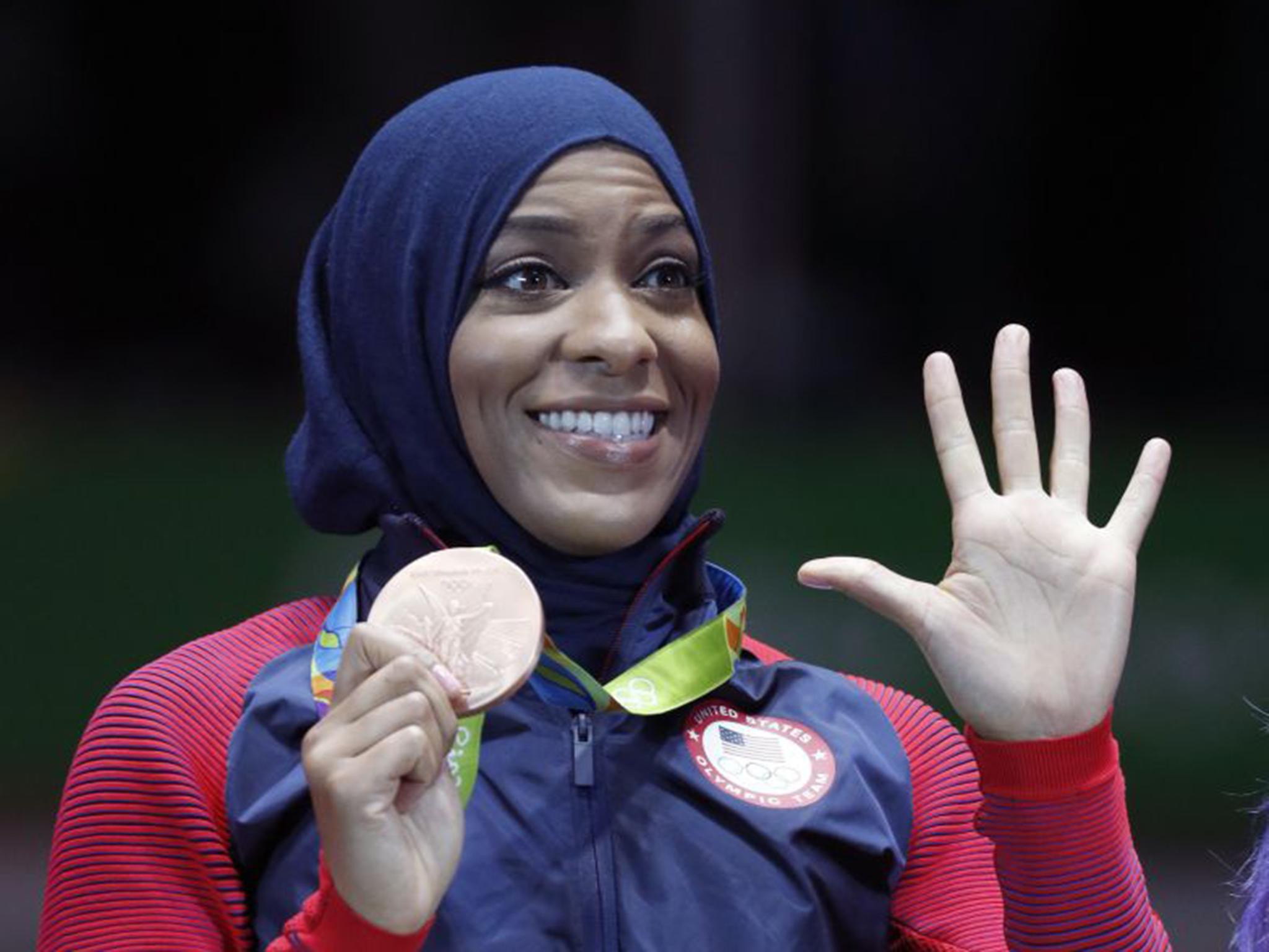 Fencer Ibtihaj Muhammad became the first Muslim-American woman to win an Olympic medal with a bronze at Rio 2016 in the team sabre event ©Getty Images