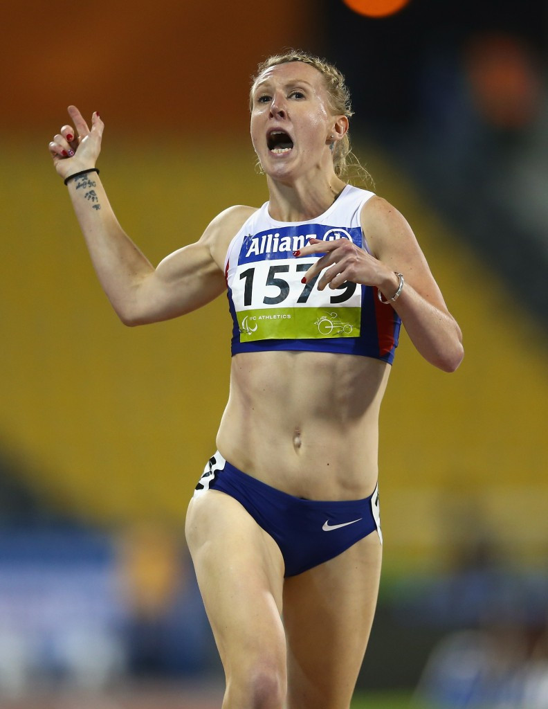 Britain's Georgina Hermitage crosses the line to win T37 400m gold in a new world record time