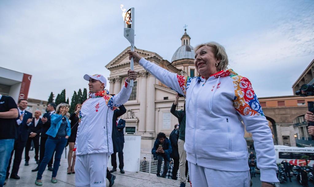 Alena Belova, right, holds aloft the Flame ©Minsk 2019