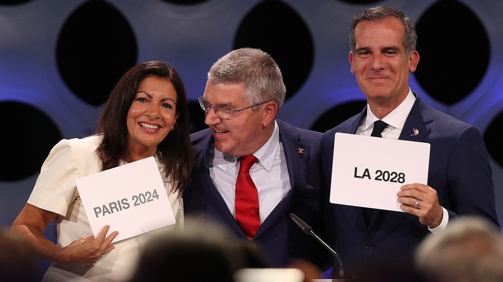 OC President Thomas Bach, centre, described the decision to award the 2024 Olympic Games to Paris and 2028 to Los Angeles simultaneously as a