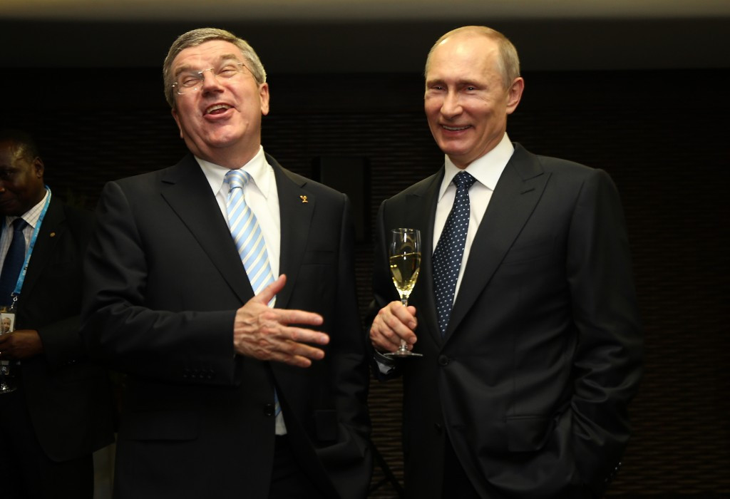Vladimir Putin (right) and Thomas Bach pictured together before the Opening Ceremony of last year's Winter Olympics, where it is claimed  the FSB carried out regular surveillance of the laboratory during the Games