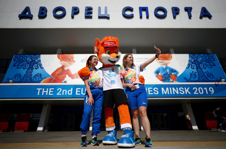 Mascot Lesik the fox and two of the 8,700  volunteers at Minsk 2019 - key players in the 2nd European Games ©Getty Images
