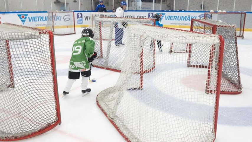 Coaches were put to work with local youngsters  ©IIHF