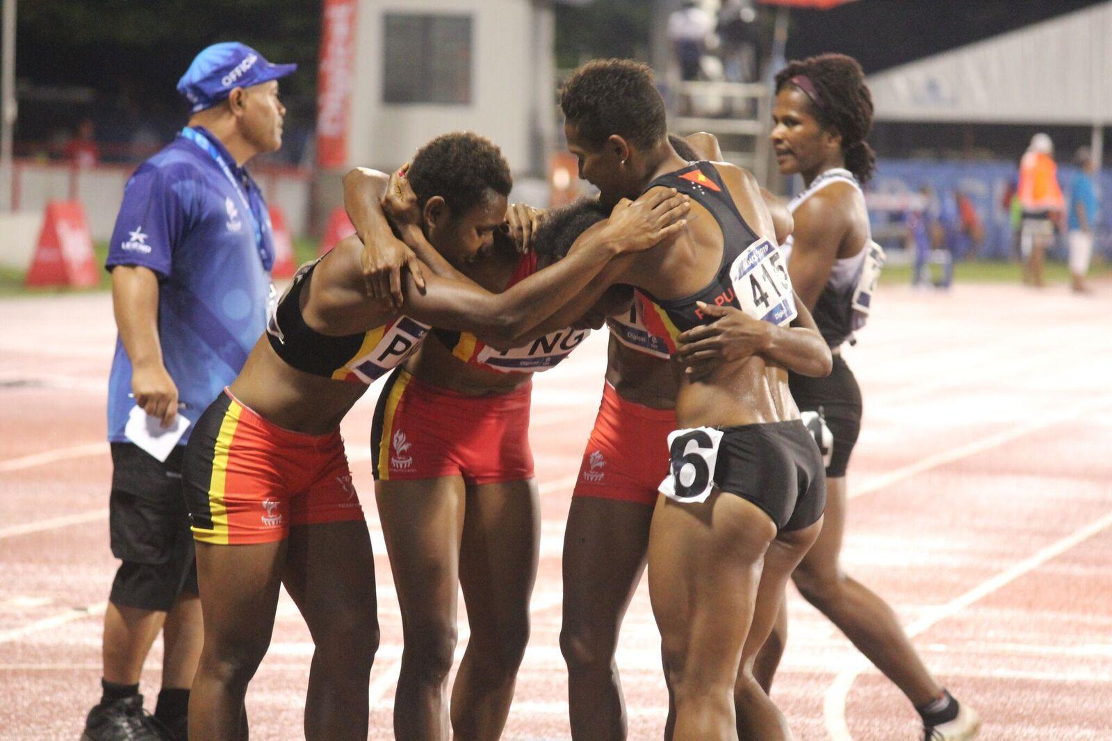 Papua New Guinea's women celebrate winning the 4x400m relay ©Samoa 2019