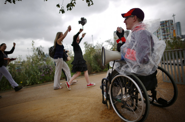 A volunteer welcomes spectators at the 2012 Paralympic Games in London, which it is claimed had a transformational effect on the attitude to disability in the host country ©Getty Images