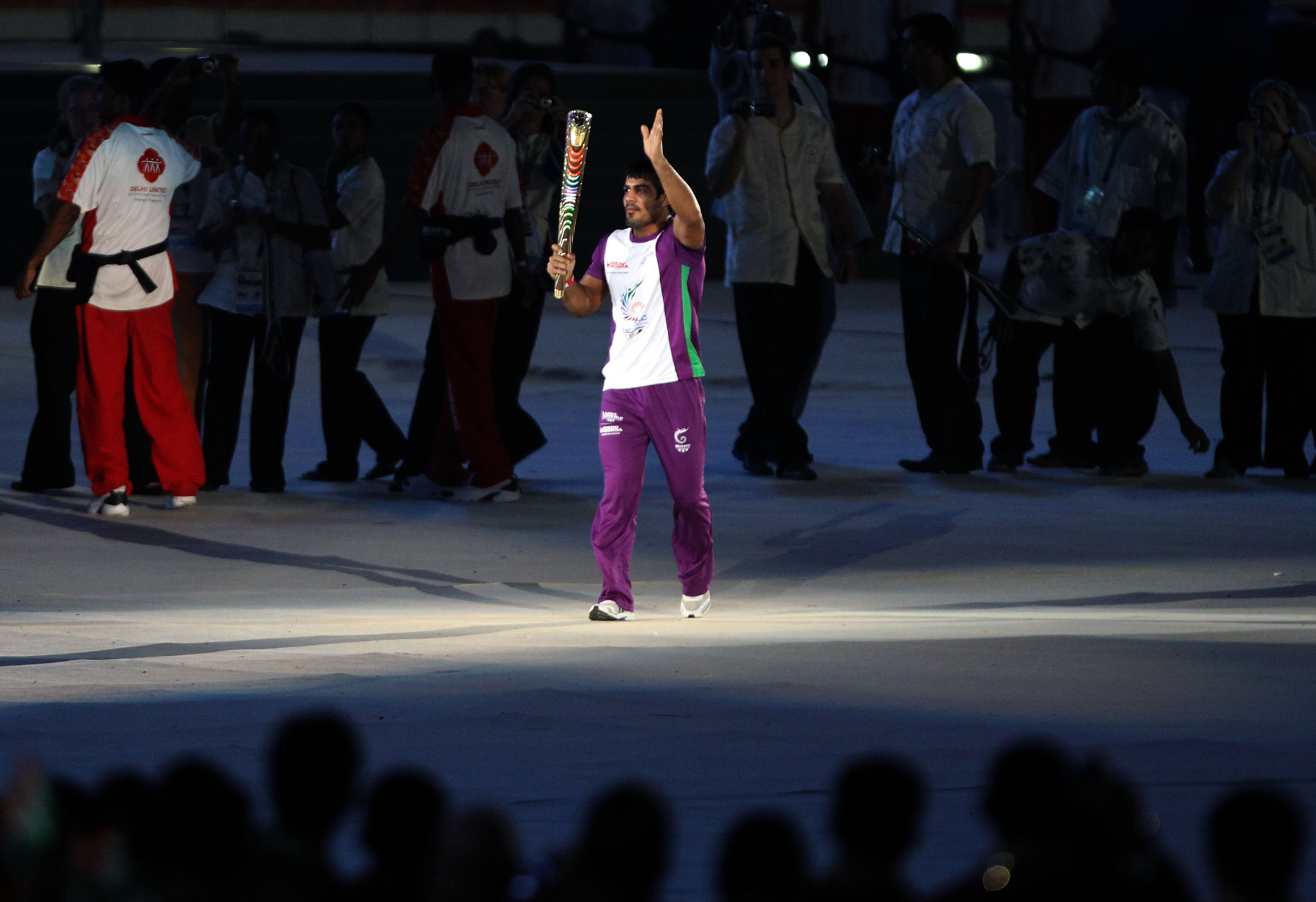 Sushil Kumar of India carries the Queen's baton during the Opening Ceremony for the Delhi 2010 Commonwealth Games at Jawaharlal Nehru Stadium ©Getty Images