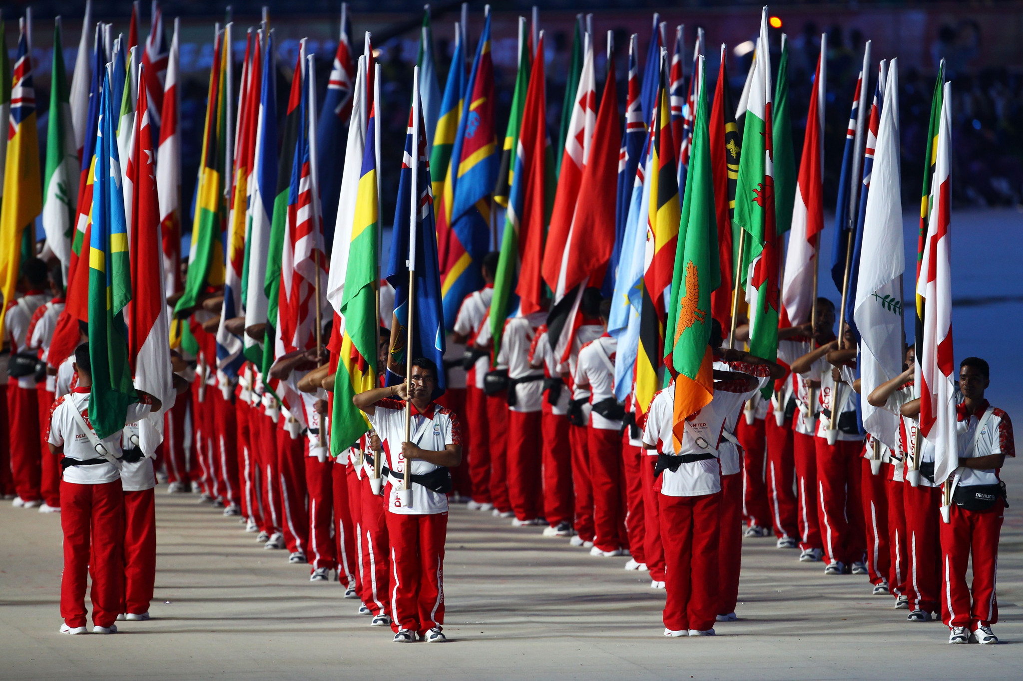 Flag bearers stand during the Opening Ceremony for the Delhi 2010 Commonwealth Games at Jawaharlal Nehru Stadium on October 3, 2010 in Delhi, India ©Getty Images