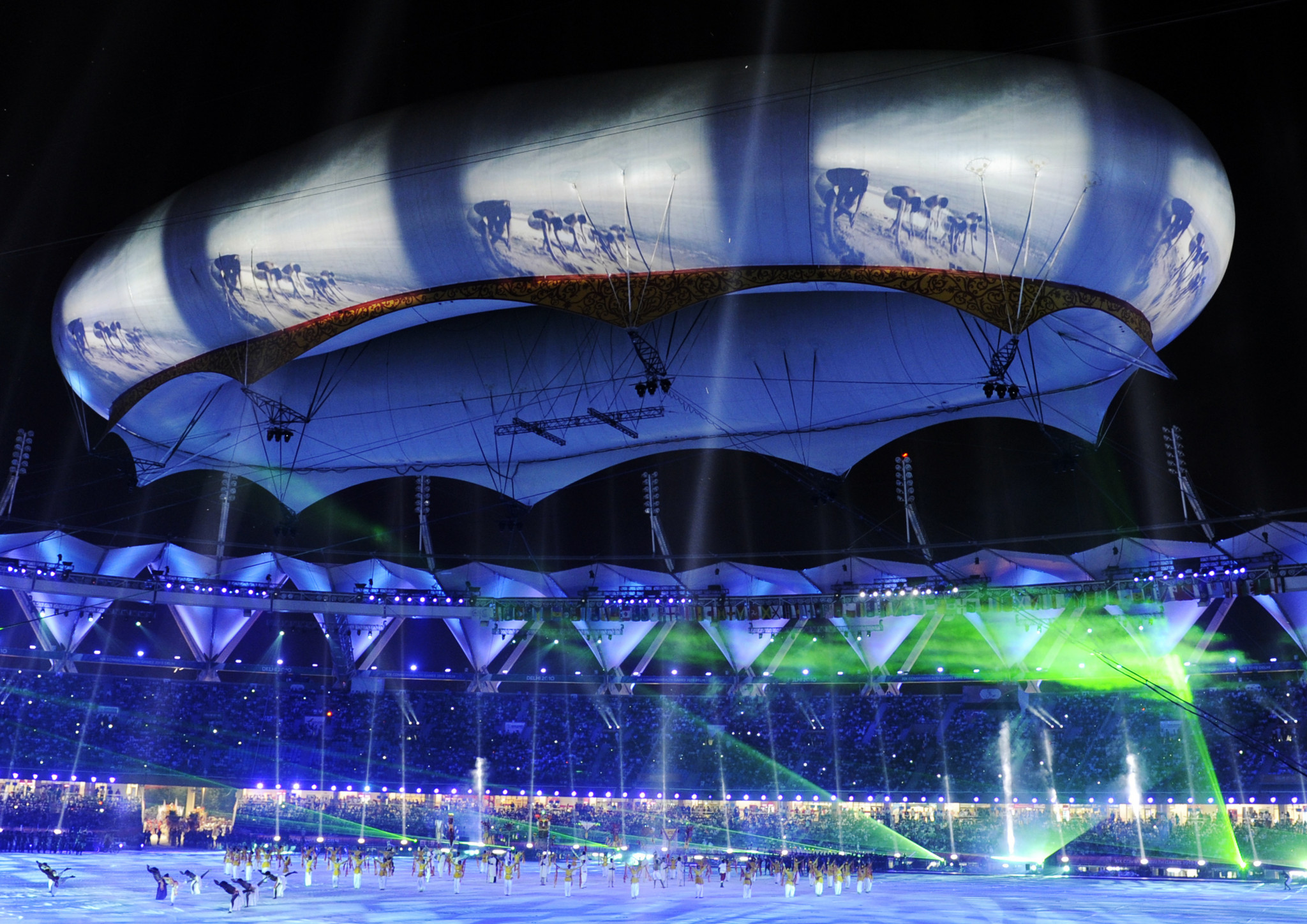 Indian dancers perform below the aerostat at the closing ceremony of the XIX Commonwealth Games at Jawarharlal Nehru Stadium in New Delhi on October 14, 2010 ©Getty Images