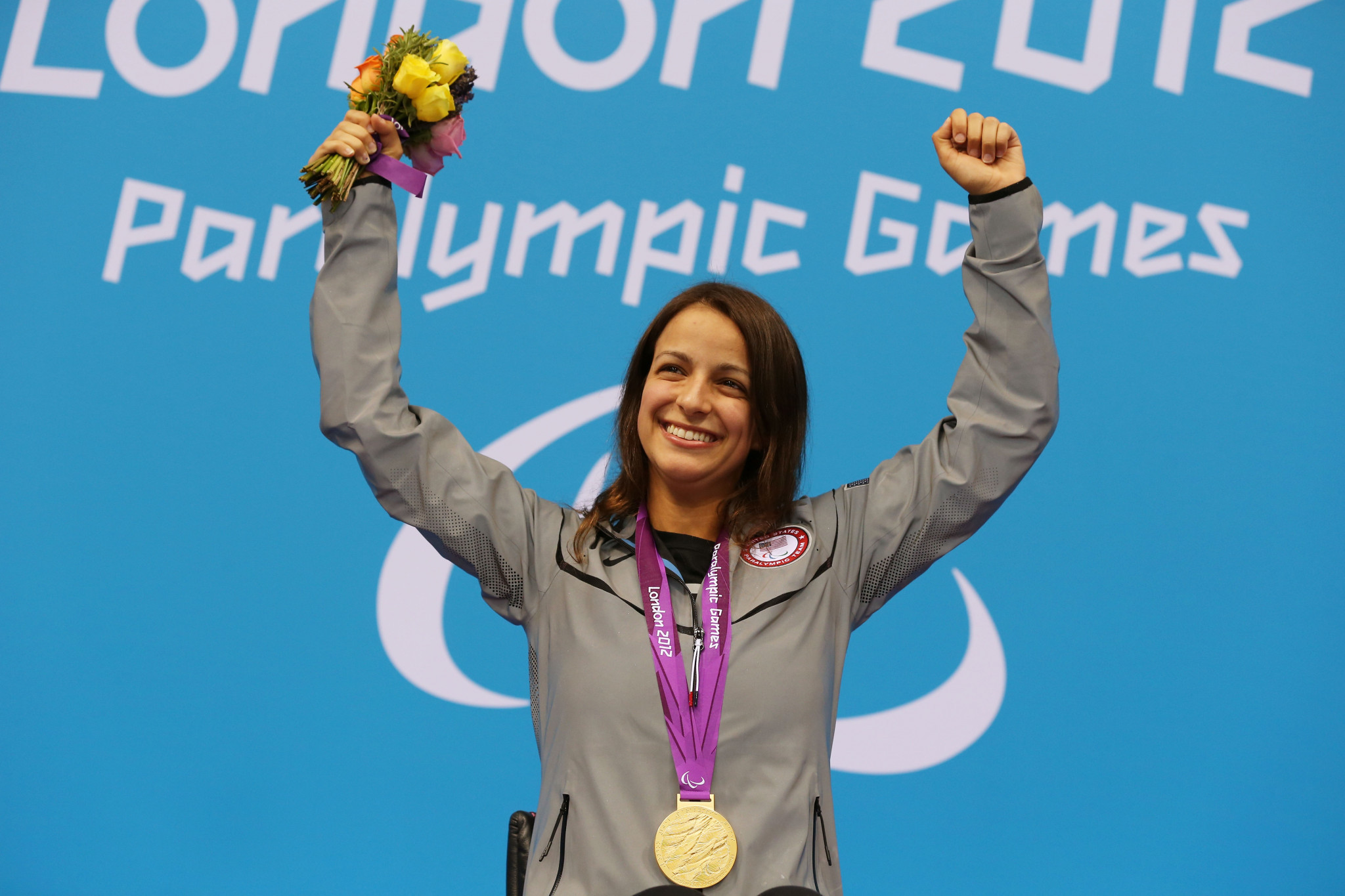 Gold medallist Victoria Arlen of the United States poses on the podium during the medal ceremony for the Women's 100m Freestyle - S6 final on day 10 of the London 2012 Paralympic Games ©Getty Images