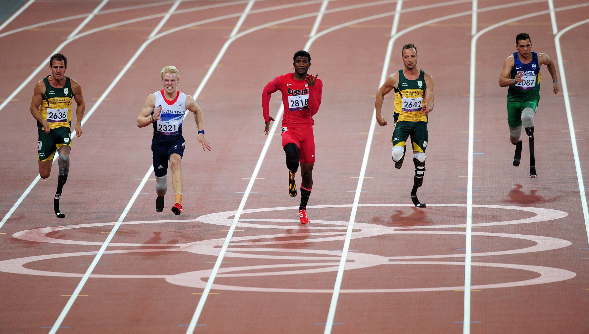 (L-R) Arnu Fourie of South Africa, Jonnie Peacock of Great Britain, Richard Browne of the United States, Oscar Pistorius of South Africa and Alan Oliveira Cardoso Oliveira of Brazil compete in the Men's 100m - T44 Final on day 8 of the London 2012 Paralympic Games ©Getty Images