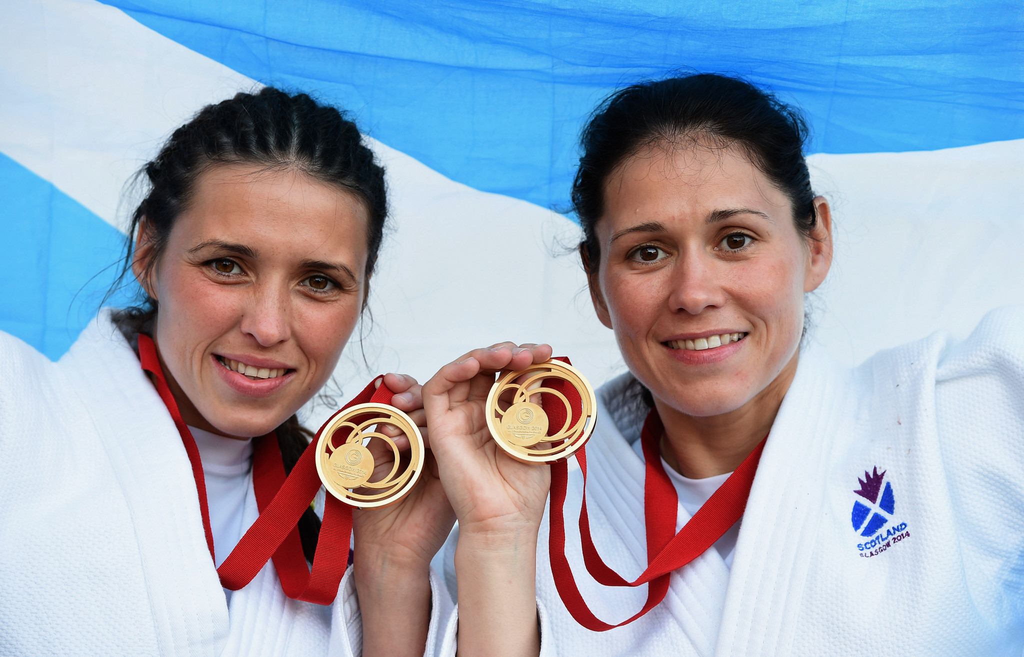 (L-R) Gold medal winning sisters Kimberley Renicks of Scotland (Women's -48kg judo) and Louise Renicks of Scotland (Women's -52kg judo) pose at SECC Precinct during day one of the Glasgow 2014 Commonwealth Games ©Getty Images