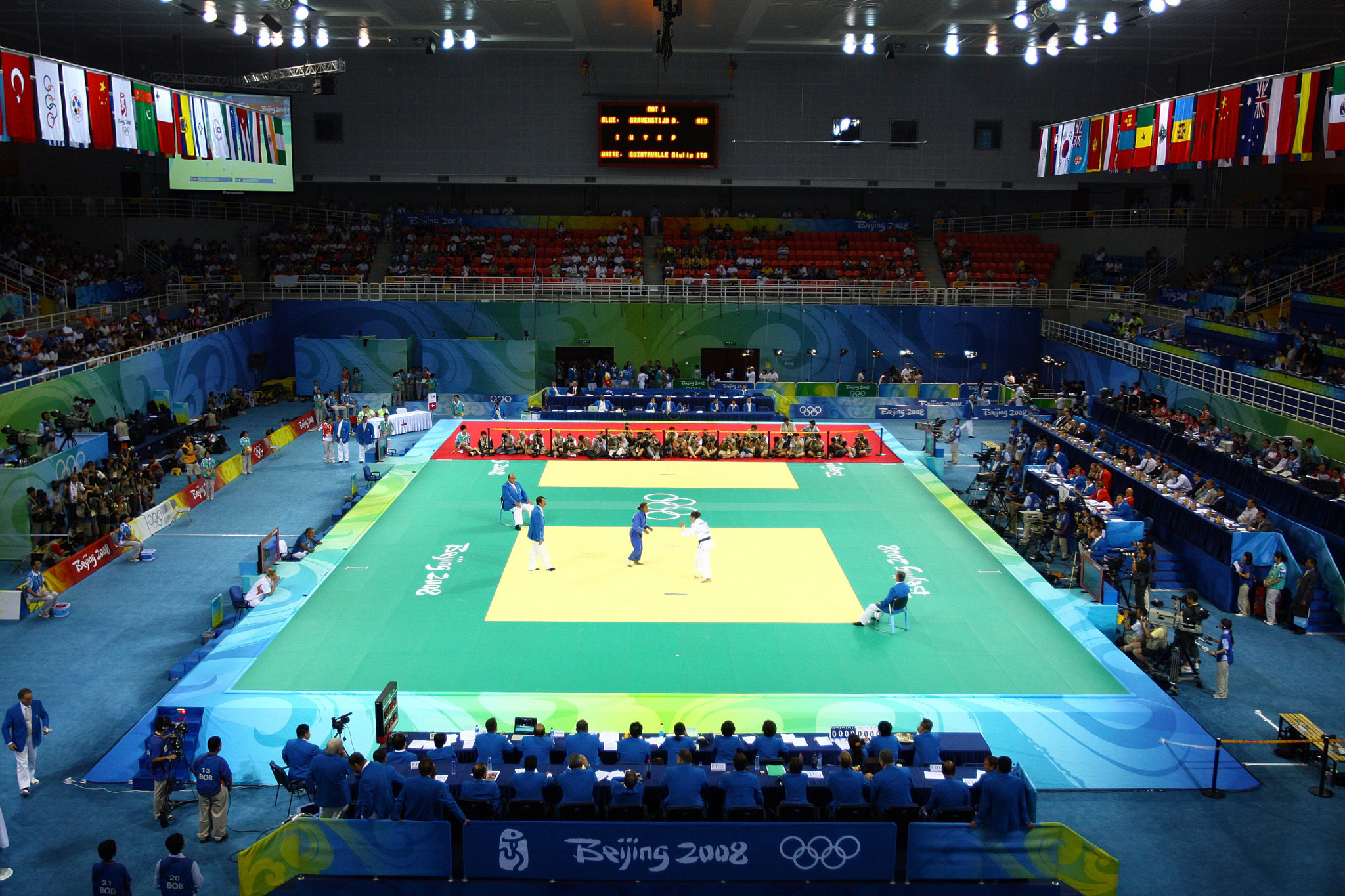 Maria Pekli (white) of Australia fights against Ketleyn Quadros of Brazil during the Women's 57 kg Judo event at the University of Science and Technology Beijing Gymnasium on Day 3 of the Beijing 2008 Olympic Games ©Getty Images
