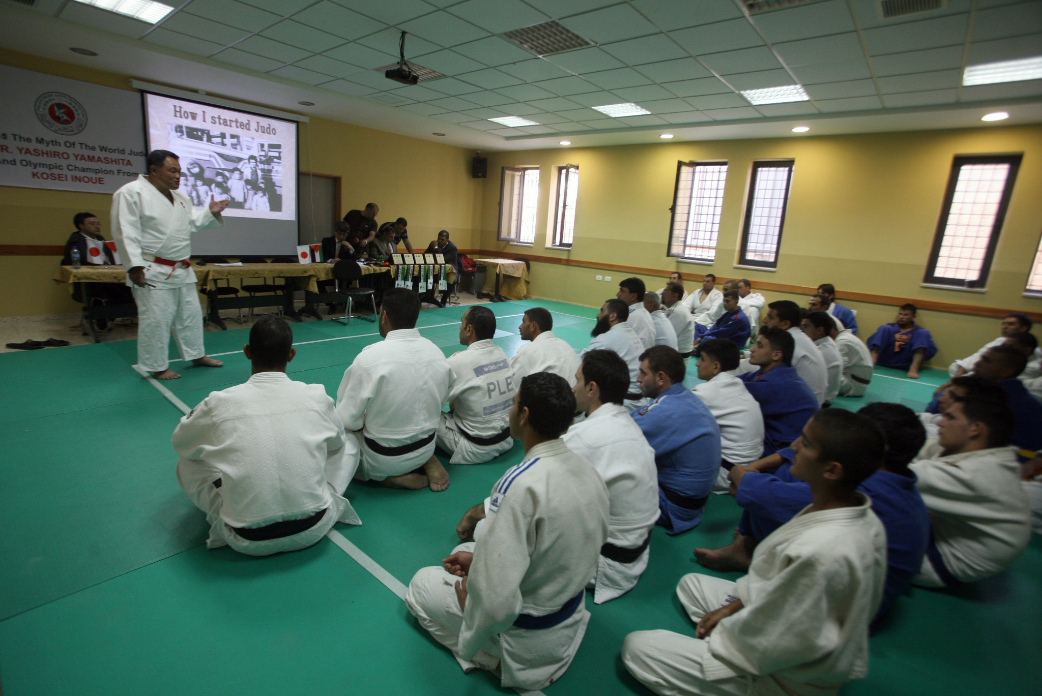 Japan's Yashiro Yamashita gives a lecture as he teaches Judo techniques to Palestinian students, members of the Judo Federation, in the biblical town of Bethlehem during his visit to the Israeli occupied Palestinian territories ©Getty Images