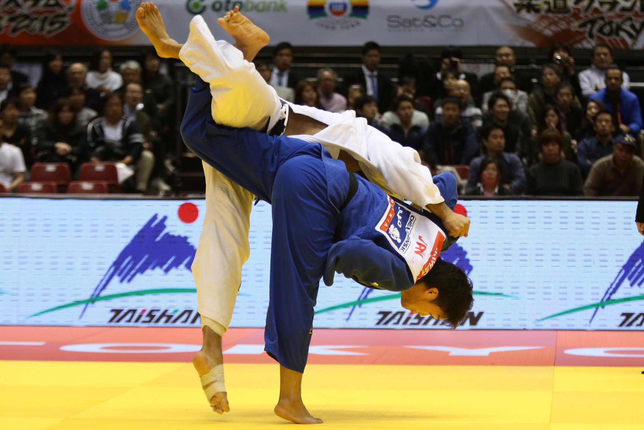 Ryunosuke Haga of Japan throws Elmar Gasimov of Azerbaijan for ippon in the Men's 100kg preliminary at Tokyo Metropolitan Gymnasium on December 6, 2015 in Tokyo, Japan ©Getty Images