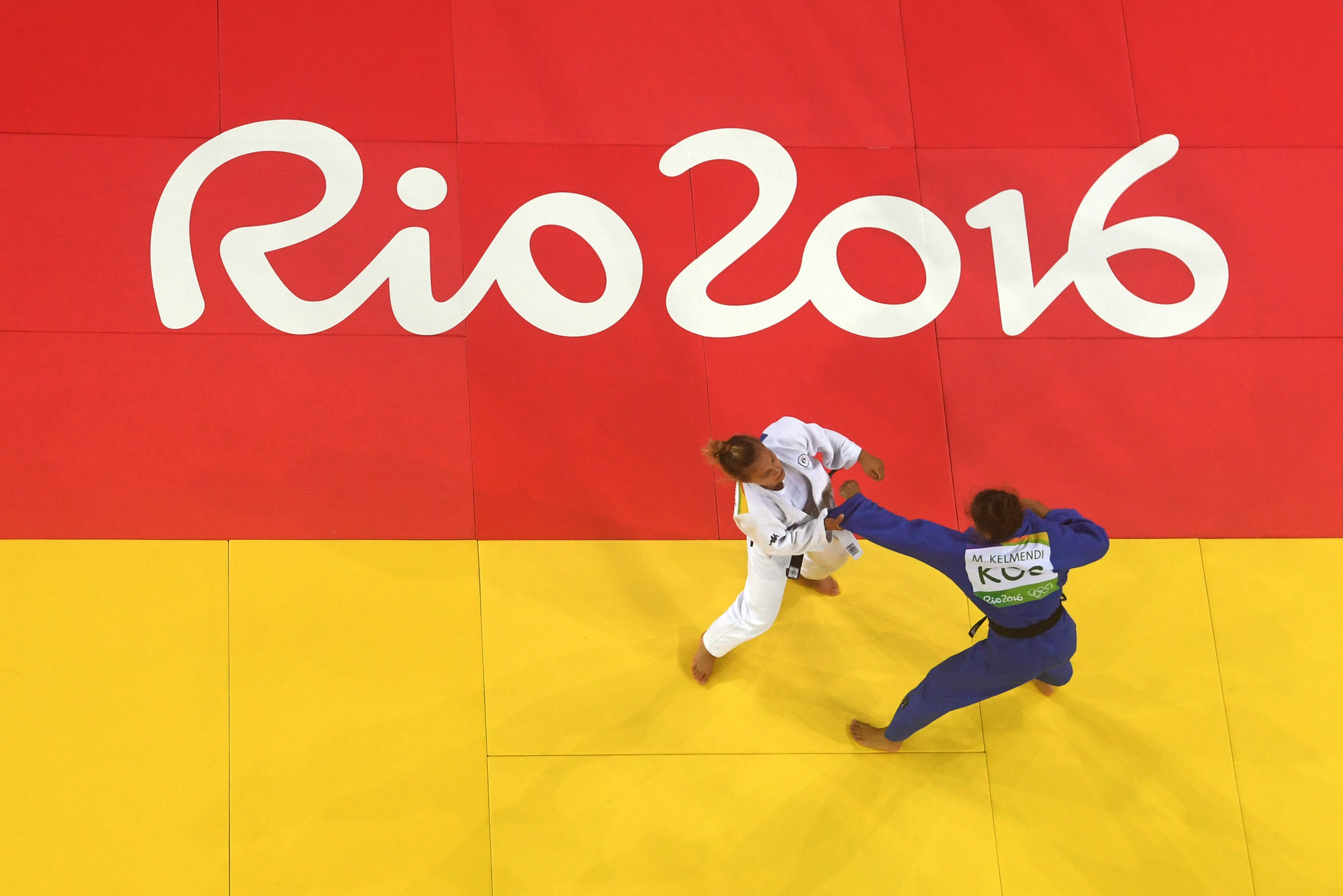 Majlinda Kelmendi of Kosovo (blue) and Odette Giuffrida of Italy compete during the Women's -52kg gold medal final on Day 2 of the Rio 2016 Olympic Games ©Getty Images