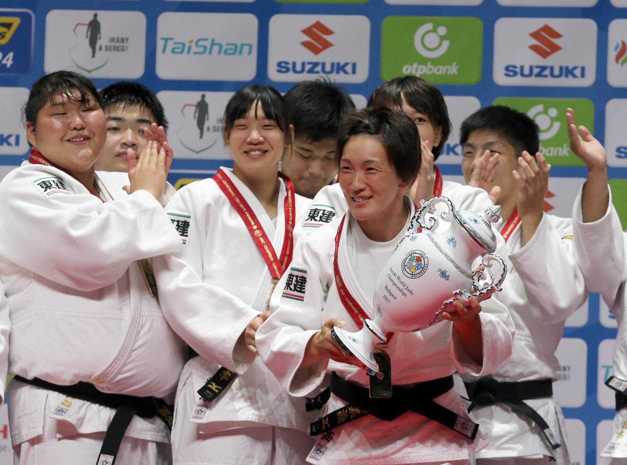 Gold winner Japan's team celebrates on the podium of the team event at the World Judo Championships in Budapest on September 3, 2017 ©Getty Images