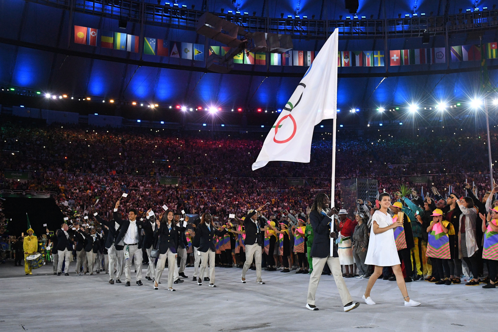 Refugee Olympic Team's flag bearer Rose Nathike Lokonyen leads the delegation during the opening ceremony of the Rio 2016 Olympic Games at the Maracana stadium ©Getty Images