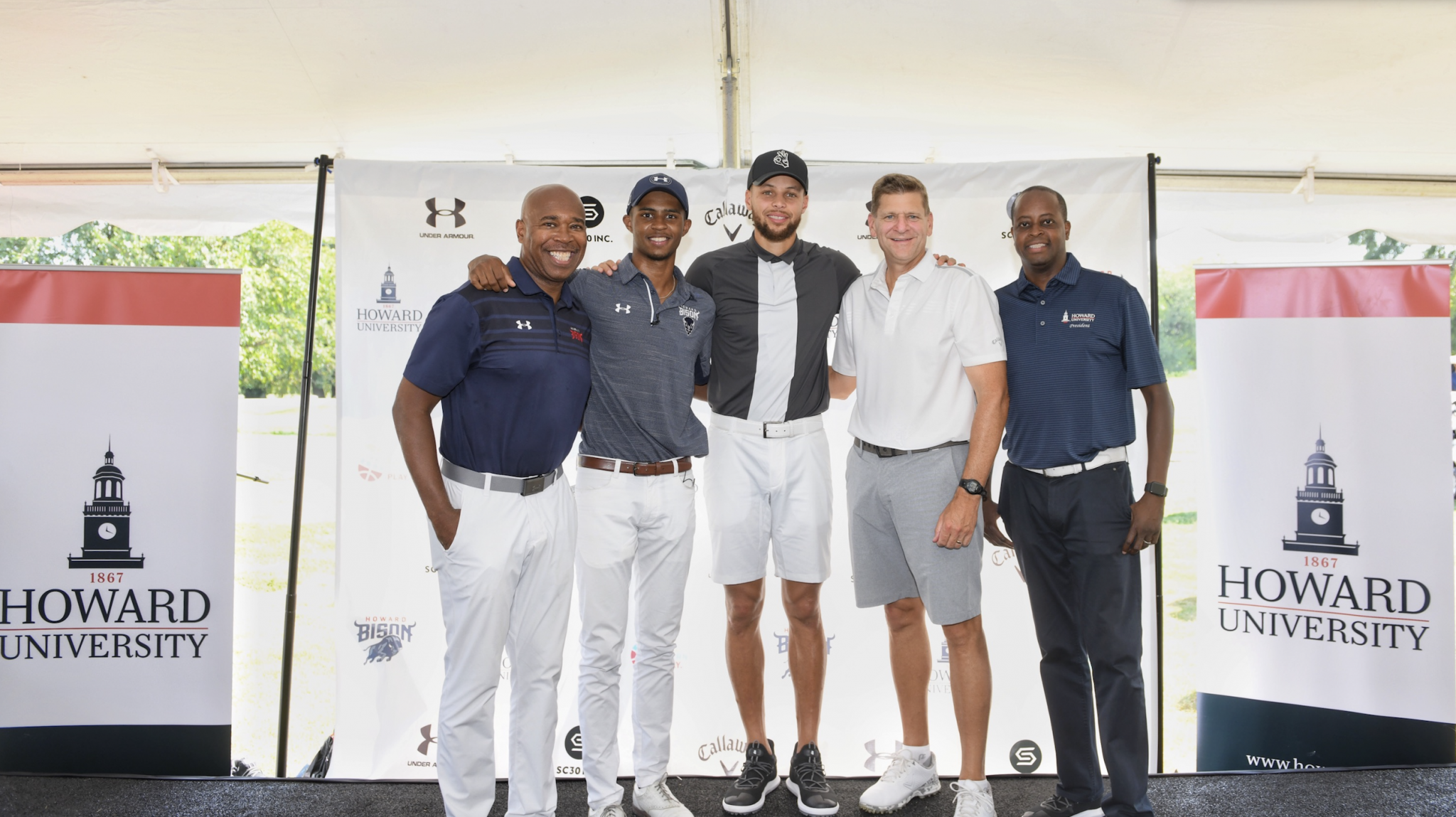Stephen Curry, centre, will support the golf programme at Howard University ©Howard University