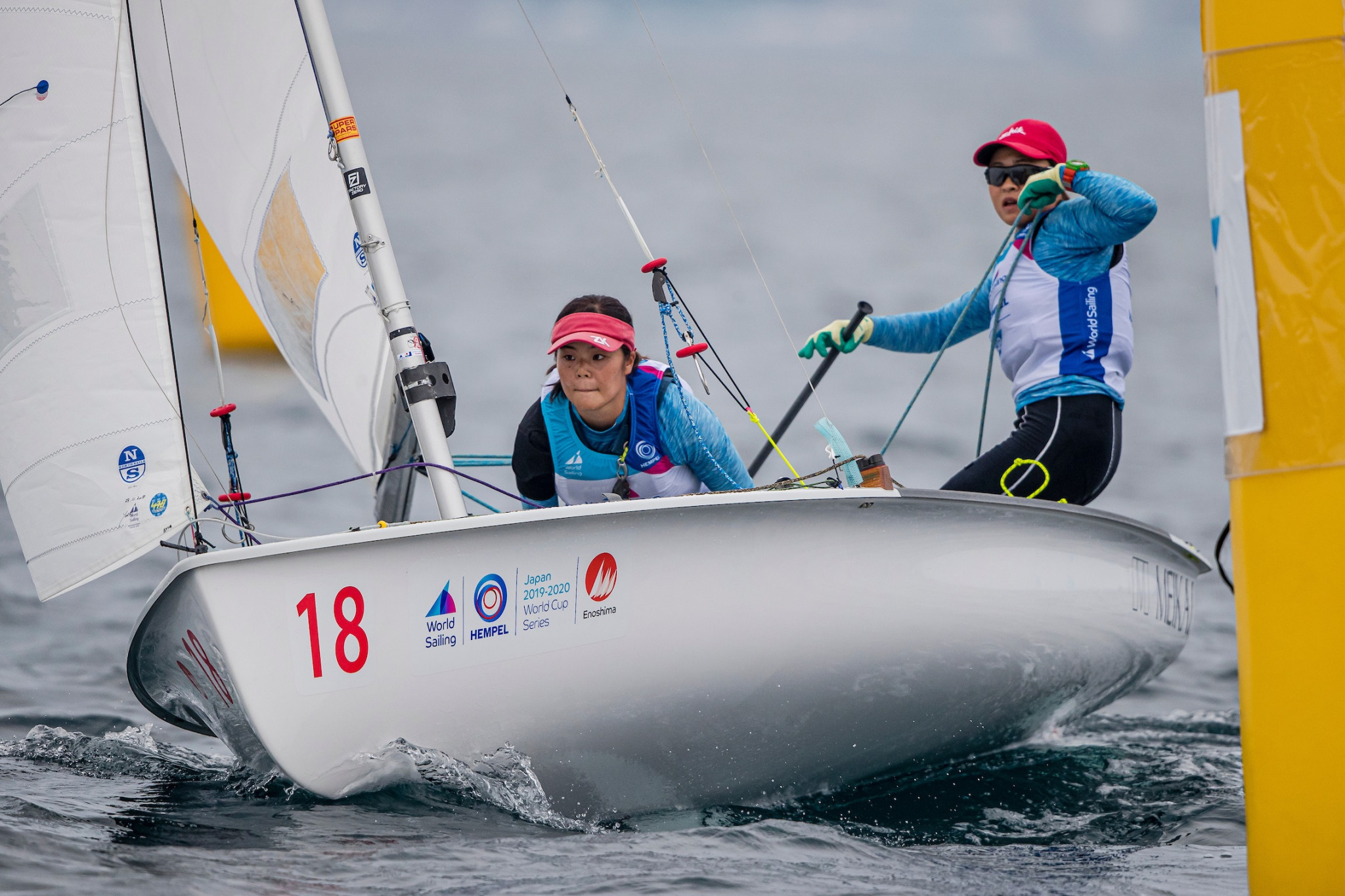 Yuki Hayashi and Chika Nishidai lead the women's 470 fleet on home water ©World Sailing