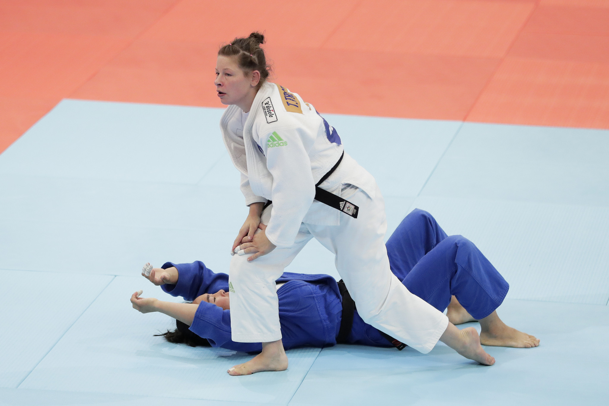 Olympic champion Tina Trstenjak, in white, was disqualified for attempting an illegal move in her semi-final ©Getty Images