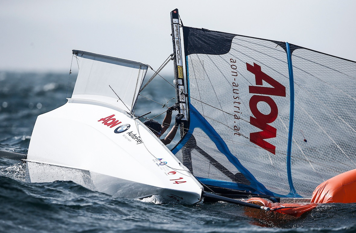 A number of boats capsized in tricky conditions ©World Sailing