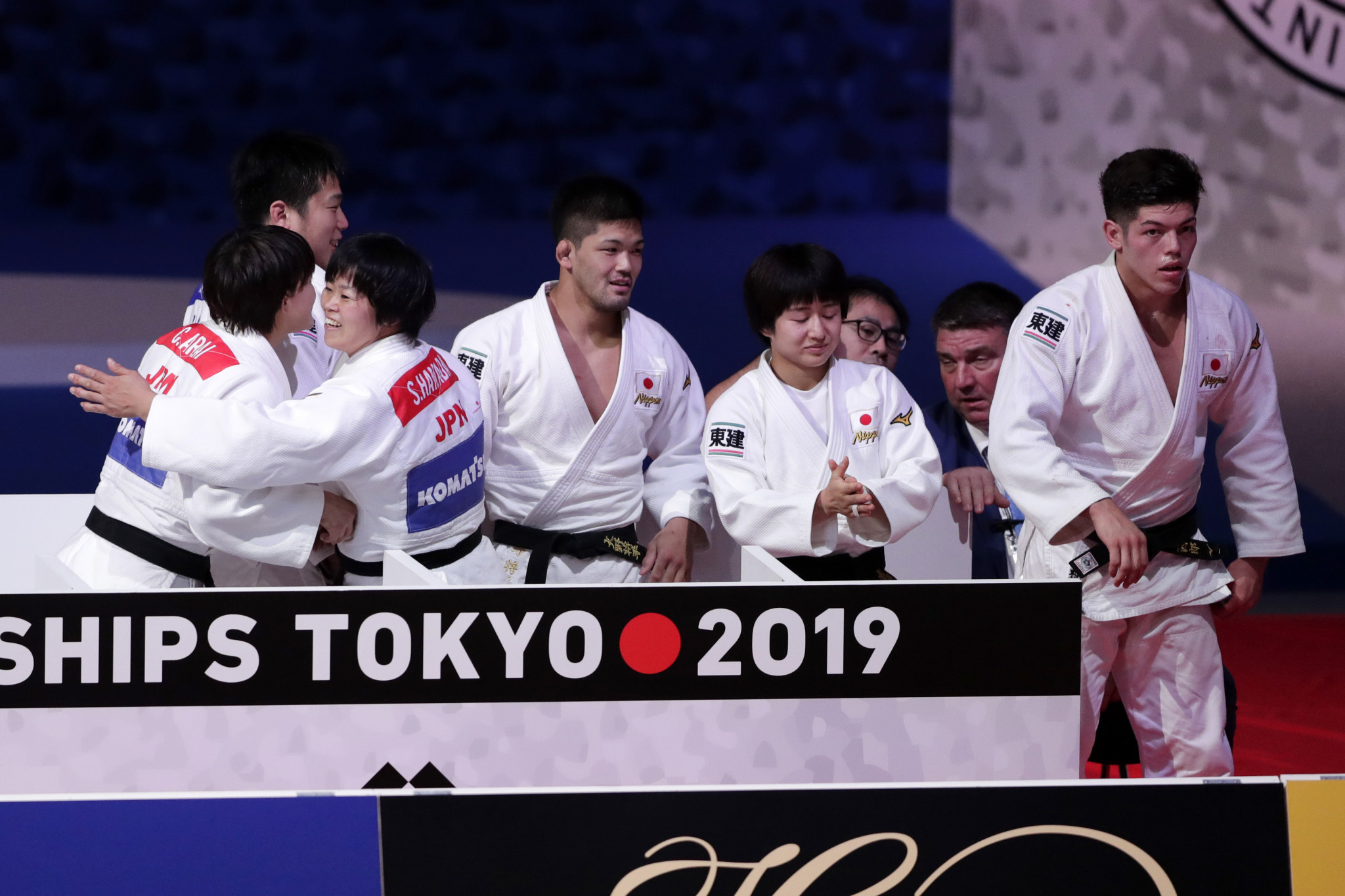 The Japan team celebrate together after claimin a hat-trick of mixed team world golds ©Getty Images