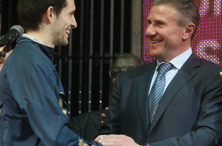 Sergey Bubka congratulates Renaud Lavillenie after the Frenchman has beaten his longstanding world pole vault record