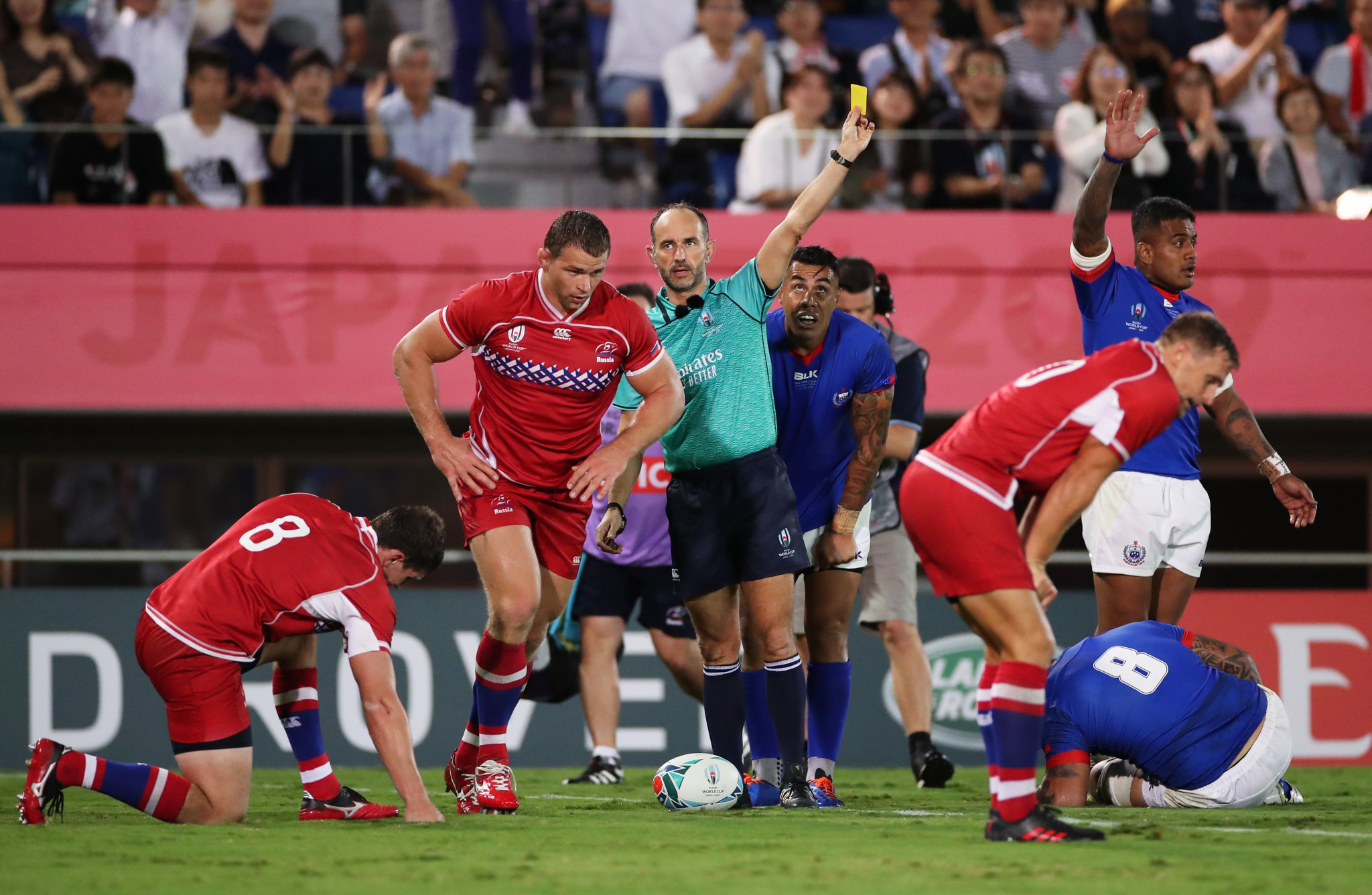 Roman Poite issues a yellow card to Russian Kirill Gotovtsev for a high tackle, while some experts said it should have been red ©Getty Images